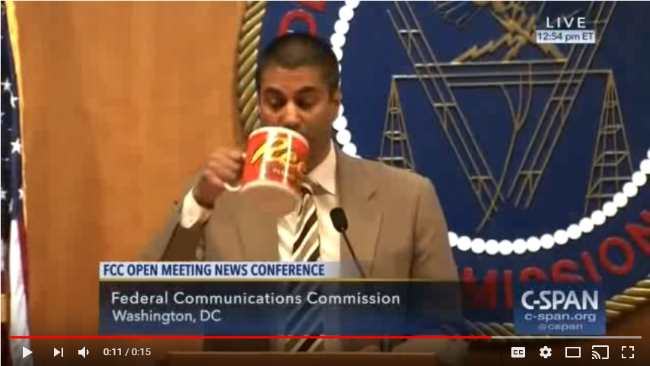 Ajit Pai drinks from mug. (C-SPAN via Sentry at YouTube)
