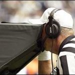 Referee viewing replay.