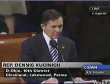 Kucinich reads Bush impeachment resolution.